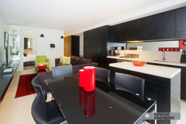 Spacious open plan kitchen, dining and living area leading to bedrooms in luxury St Kilda Vic apartment - 102/27 Herbert Street