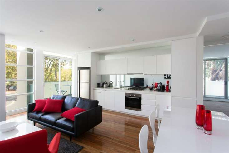 Living, dining kitchen view including wall air conditioning in Superb apartment in Elwood Vic - 102/60-62 Broadway
