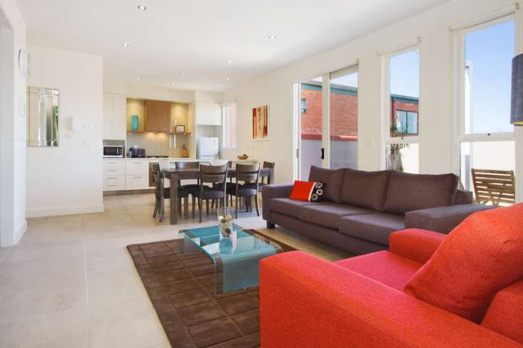 Gorgeous long and spacious tiled Open Plan living room, dining and kitchen  and Australian art in  luxury apartment in East St Kilda -  13/114a Westbury Close