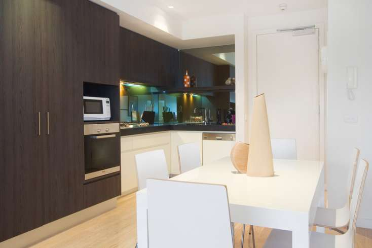 Designer eat in kitchen with all modern appliances including espresso machine in Luxury short stay apartment in Elwood Vic - 13/30 Docker Street