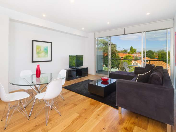 View of living area to street with timber vflooring in Short stay apartment in Glen Iris Vic - 204/220 Burke Road