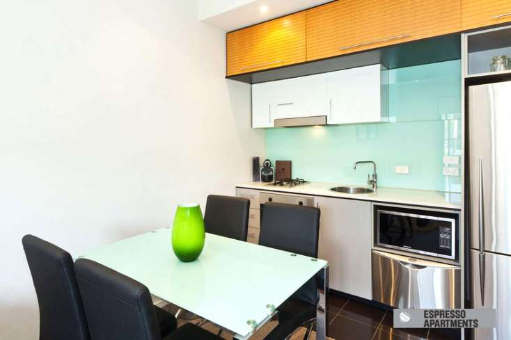 Luxury Dining area and kitchen in luxury short stay apartment in St Kilda - 23/220 Barkly Street