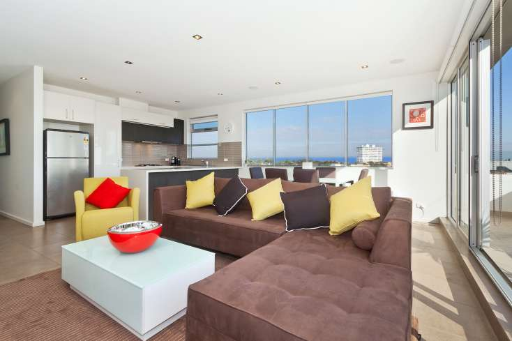 Ocean views from large Open Plan living room in luxury short stay in St Kilda - 32/23 Irwell Street