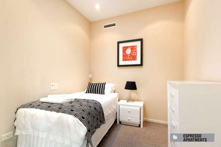 second bedroom with king single bed and wall art in luxury St Kilda Apartment - 38/220 Barkly Street