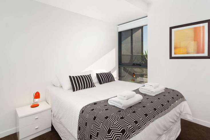 Master Queen Bedroom with designer soft furnishings in luxury St Kilda apartment - 802/181 St Kilda Road